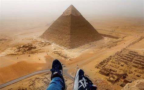 Daredevil tourist scales the heights for pyramid scheme